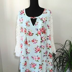 Ty Alexander's floral blouse with lace sleeves